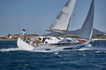 Sun Odyssey 440 Under sail in high winds and open water.